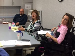 A meeting of the Fox Valley Advocacy Coalition showing three of its members.